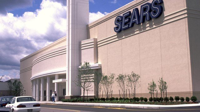 Sears is shutting down 150 more stores, yet another sign of how tough it is for former kings of the retail industry to compete in a world now dominated by Amazon. File- Image of Sears Storefront. (Photo Credit: CNNMoney).