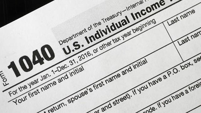 (AP Photo/Mark Lennihan). A 1040 tax form appears on display, Tuesday, Jan. 10, 2017, in New York. The IRS is delaying tax refunds for millions of low-income families as the agency steps up efforts to combat identity theft and fraud.