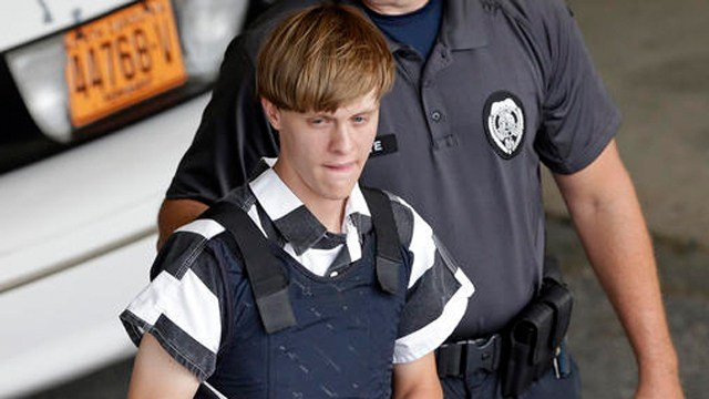 (AP Photo/Chuck Burton, File). FILE - In this June 18, 2015 file photo, Charleston, S.C., shooting suspect Dylann Roof is escorted from the Cleveland County Courthouse in Shelby, N.C.