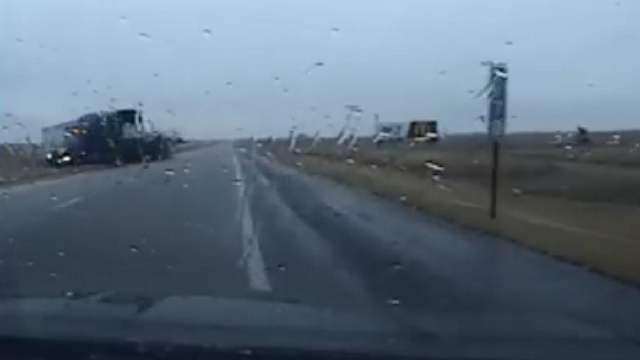 Dramatic video shows semi almost hit patrol auto in Russell County