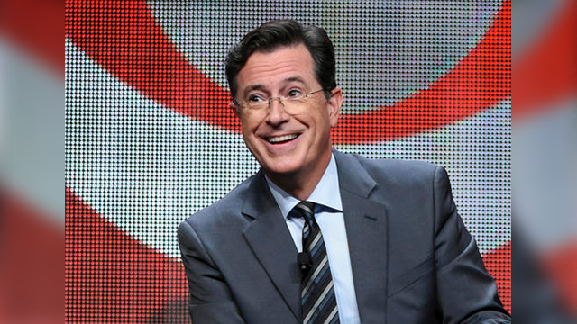 "Photo by Richard Shotwell/Invision/AP, File). FILE - In this Aug. 10, 2015 file photo, Stephen Colbert participates in the ""The Late Show with Stephen Colbert"" segment of the CBS Summer TCA Tour in Beverly Hills, Calif."
