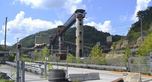 In this Aug. 31, 2016 photo, a coal mine owned by West Virginia gubernatorial candidate Jim Justice sits idle near Hindman, Ky. Justice's coal companies owe millions in taxes to several Kentucky counties amid a decline in production. (AP Photo/Dylan)