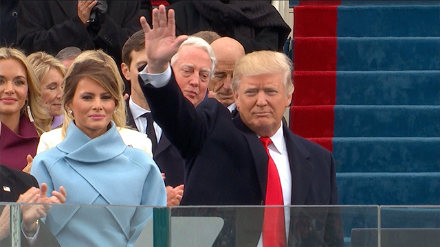 Donald Trump waves to the crowd at his inauguration on January 20, 2017.