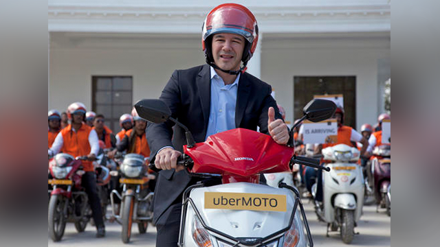 (AP Photo/Mahesh Kumar A., File). FILE - In this Dec. 13, 2016, file photo, former Uber CEO Travis Kalanick, poses during the launch of its bike-sharing product, uberMOTO, in Hyderabad, India.