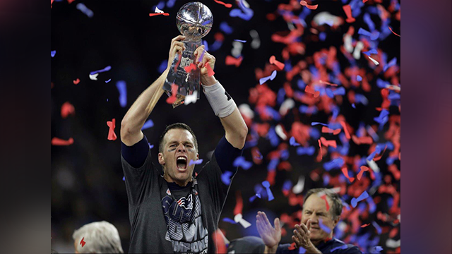 "(AP Photo) ""We're bringing this sucker home!"" -Tom Brady while holding the Patriots' fifth Lombardi Trophy."