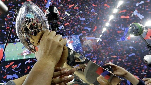 The New England Patriots players hoist the Vince Lombardi Trophy after defeating the Atlanta Falcons in the NFL Super Bowl 51 football game Sunday, Feb. 5, 2017, in Houston.  (AP Photo/Eric Gay)