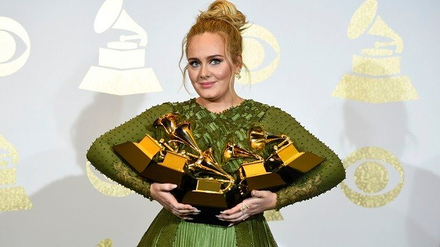 "Adele won awards for album of the year for ""25"", song of the year for ""Hello"", record of the year for ""Hello"", best pop solo performance for ""Hello"", and best pop vocal album for ""25."" (Photo by Chris Pizzello/Invision/AP)"