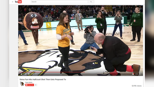 Siena graduate Erin Tobin, 30, made a half-court shot, won a $500 gift and received a proposal seconds later. (Credit: Siena Saints/Youtube)
