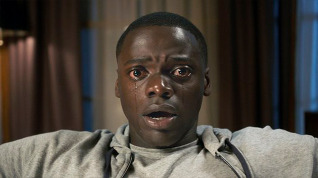"(Universal Pictures via AP). This image released by Universal Pictures shows Daniel Kaluuya in a scene from, ""Get Out."""