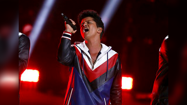(Photo by Matt Sayles/Invision/AP, File). FILE - This Feb. 12, 2017 file photo shows Bruno Mars performing at the 59th annual Grammy Awards in Los Angeles. Mars, Katy Perry, Ed Sheeran, Shawn Mendes and The Chainsmokers will perform at Sunday's iHeartR...