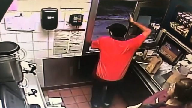 McDonald's employee jumps out drive thru window to assist off-du