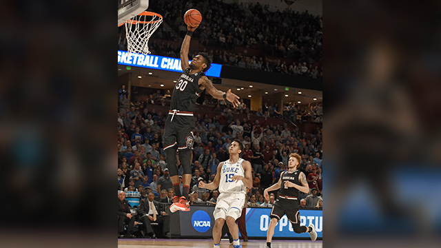 South Carolina's Chris Silva goes up to dunk past Duke's Frank Jackson during the second half in a second-round game of the NCAA men's college basketball tournament in Greenville S.C. Sunday