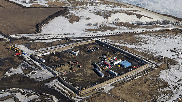 (Tom Stromme/The Bismarck Tribune via AP, File) FILE - In this Feb. 13, 2017, aerial file photo shows the site where the final phase of the Dakota Access Pipeline will take place with boring equipment routing the pipeline underground and across Lake...