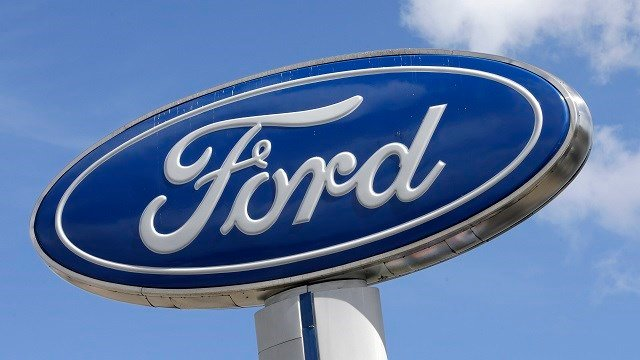 This Tuesday, Jan. 17, 2017, photo shows a Ford sign at an auto dealership, in Hialeah, Fla. Ford Motor Co. says a change in the way it values pension assets will cut 2016 full-year net income by $2 billion. (AP Photo/Alan Diaz)
