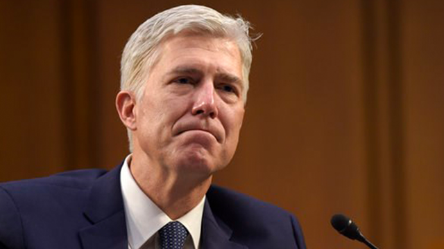 (AP Photo/Susan Walsh, File). FILE - In this Wednesday, March 22, 2017, file photo, Supreme Court Justice nominee Neil Gorsuch listens as he is asked a question by Sen. Mazie Hirono, D-Hawaii, on Capitol Hill in Washington, during his confirmation hear...