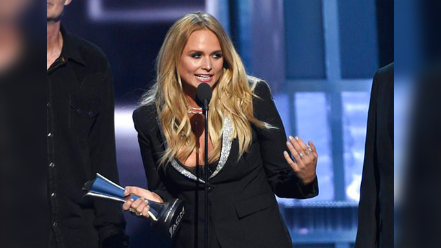"(Photo by Chris Pizzello/Invision/AP). Miranda Lambert accepts album of the year for ""The Weight of These Wings"" at the 52nd annual Academy of Country Music Awards at the T-Mobile Arena on Sunday, April 2, 2017, in Las Vegas."