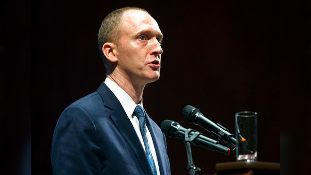 AP Photo/Pavel Golovkin, File). FILE - In this Friday, July 8, 2016, file photo, Carter Page, then adviser to U.S. Republican presidential candidate Donald Trump, speaks at the graduation ceremony for the New Economic School in Moscow, Russia. A forei...