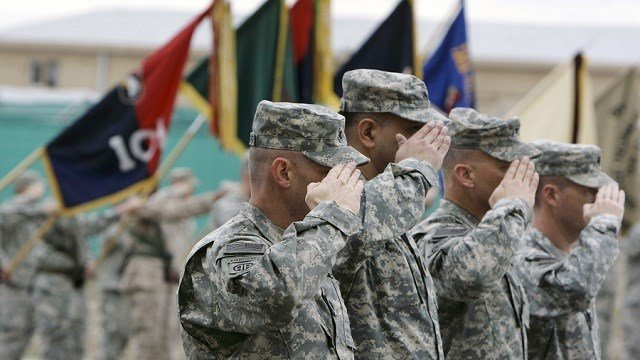 In this April 10, 2008 file photo, U.S. soldiers salute during a handover ceremony at the main U.S. base at Bagram north of Kabul, Afghanistan. (Source: AP Photo, File)