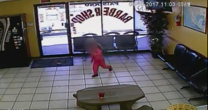 Caught on cam: Gunfire narrowly misses little girl in barbershop