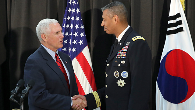 (AP Photo/Lee Jin-man) U.S. Vice President Mike Pence, left, shakes hands with U.S. Gen. Vincent Brooks, commander of the United Nations Command, US Forces Korea and Combined Forces Command before a dinner with soldiers and family members...