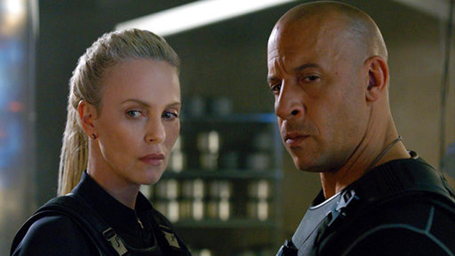 "This image released by Universal Pictures shows Charlize Theron, left, and Vin Diesel in ""The Fate of the Furious."" (Universal Pictures via AP) (THE ASSOCIATED PRESS)"