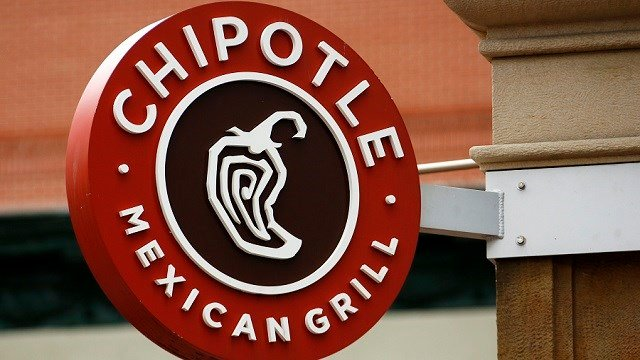 This Thursday, Jan. 12, 2017, photo shows the sign on a Chipotle restaurant in Pittsburgh. (AP Photo/Gene J. Puskar)