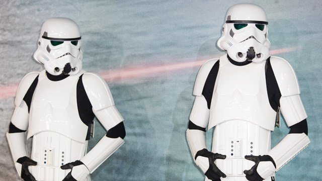 Two Stormtroopers pose for photographers upon arrival at the premiere of the film 'Rogue One: A Star Wars Story' in London, Tuesday, Dec. 13, 2016. (Photo by Vianney Le Caer/Invision/AP)