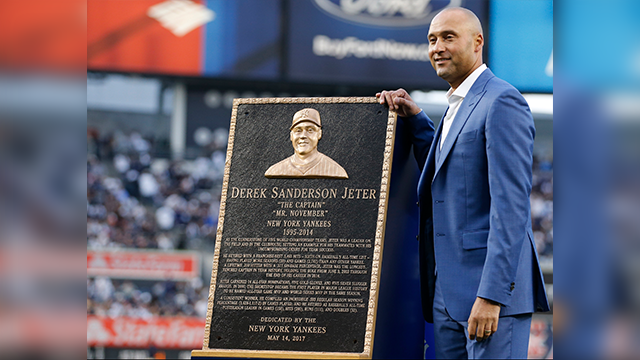 (AP Photo/Kathy Willens, Pool) Retired New York Yankees shortstop Derek Jeter poses with the plaque that will be installed in Monument Park during a pregame ceremony retiring his number 2 at Yankee Stadium in New York, Sunday, May 14, 2017.