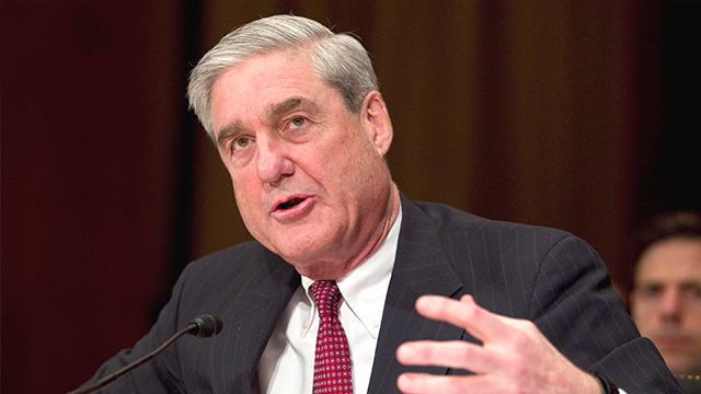 (AP Photo/Evan Vucci, File) FILE - In this March 30, 2011 file photo, FBI Director Robert Mueller testifies on Capitol Hill in Washington.