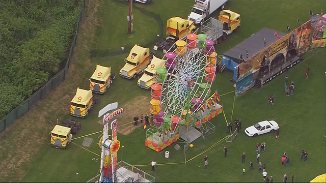 Two adults, one child hospitalized after falling from Ferris wheel