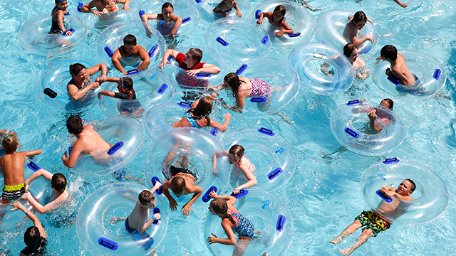Swimmers use tubes in the wave pool at the Rolling Hills Water Park in Ypsilanti, Mich., Wednesday, Aug. 5, 2015. (AP Photo/Paul Sancya)