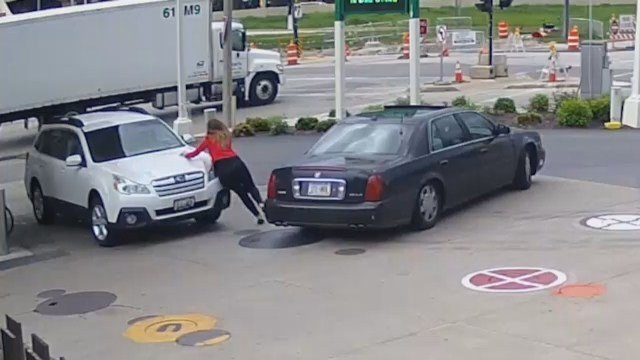 Must See: Woman fights off would-be carjackers by jumping on the hood