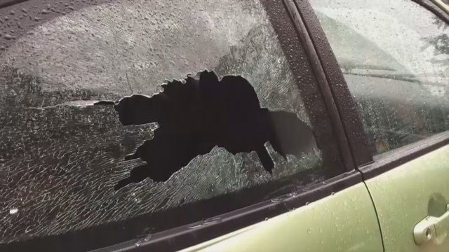 Toddler hit by brick thrown through car window