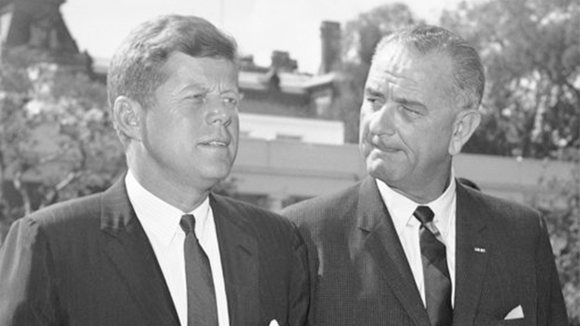 (AP Photo/Byron Rollins). FILE - In this Aug. 22, 1962 file photo, President John F. Kennedy walks with Vice President Lyndon Johnson, right, on the White House south grounds as Johnson started a trip to Italy and the Middle East. Monday, May 29, 2017 ...