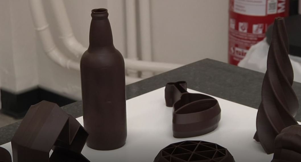 A beer bottle, a bat and various other shapes lie created in chocolate in this laboratory in the Belgian town of Gembloux. (Photo: AP)