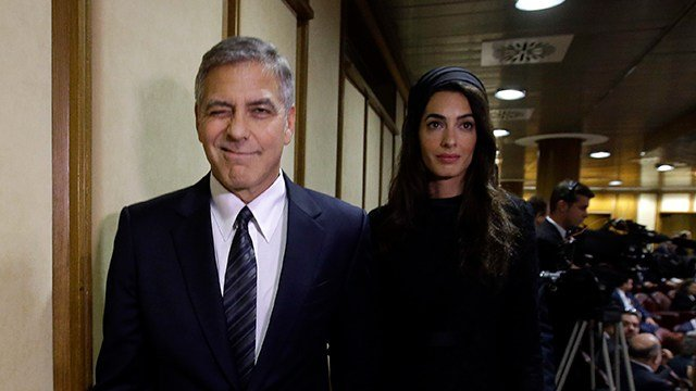 George and Amal Clooney have welcomed twins Ella and Alexander Clooney. (AP Photo/Gregorio Borgia)