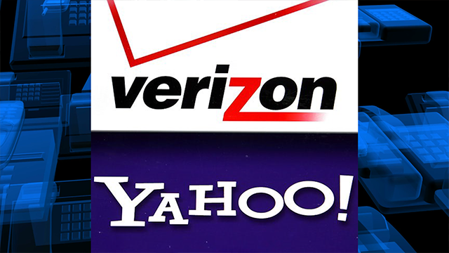 (AP Photo/Elise Amendola, File). FILE - This Monday, July 25, 2016, file photo shows the Verizon and Yahoo logos on a laptop, in North Andover, Mass. Verizon is buying Yahoo in hopes of challenging Google and Facebook in the digital advertising market ..