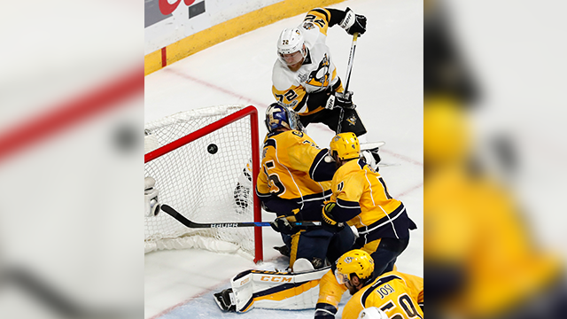 (AP Photo/Jeff Roberson) Pittsburgh Penguins' Patric Hornqvist (72), of Sweden, scores a goal against Nashville Predators goalie Pekka Rinne, of Finland, during the third period of Game 6 of the NHL hockey Stanley Cup Final.