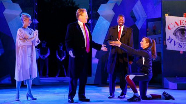 (Joan Marcus/The Public Theater via AP). FILE - In this May 21, 2017, file photo provided by The Public Theater, Tina Benko, left, portrays Melania Trump in the role of Caesar's wife, Calpurnia, and Gregg Henry, center left, portrays President Donald T...