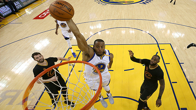 (Ezra Shaw/Pool Photo via AP) Golden State Warriors forward Andre Iguodala (9) dunks between Cleveland Cavaliers forward Kevin Love (0) and forward LeBron James (23) during the first half of Game 5 of basketball's NBA Finals in Oakland, Calif.