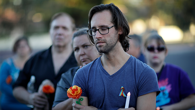 (AP Photo/John Locher) Sean Stuart attends a vigil at the Gay & Lesbian Community Center of Southern Nevada on the one-year anniversary of the shootings at Orlando's Pulse nightclub, Monday, June 12, 2017, in Las Vegas.
