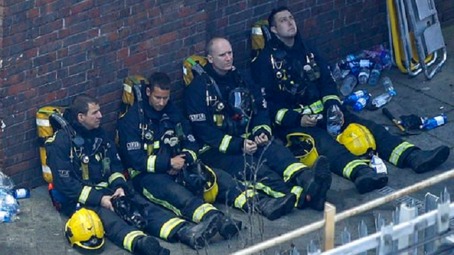 (AP Photo/Matt Dunham). Firefighters rest as they take a break in battling a massive fire that raged in a high-rise apartment building in London, Wednesday, June 14, 2017.