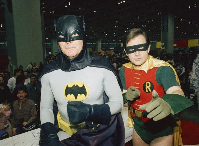 "In this Jan. 27, 1989, file photo, actors Adam West, left, and Burt Ward, dressed as their characters Batman and Robin, pose for a photo at the ""World of Wheels"" custom car show in Chicago. (AP Photo/Mark Elias, File)"