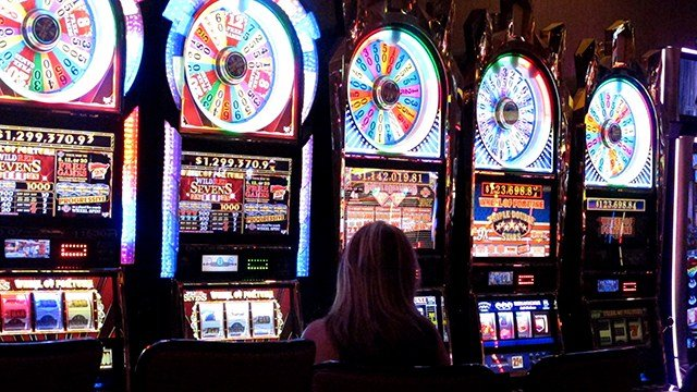 This June 24, 2016 file photo shows gamblers playing slot machines in Atlantic City. (AP Photo/Wayne Parry)