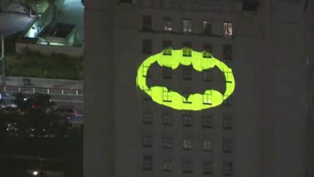 The Bat-Signal went up Thursday night in Los Angeles to honor beloved actor Adam West. (Source: KTLA via CNN)