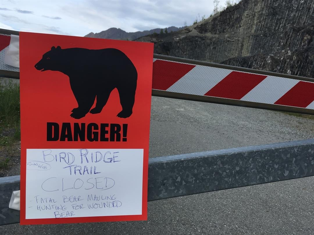 A sign warns people that the trail head is closed on Monday, June 19, 2017, after a fatal bear mauling at Bird Ridge Trail in Anchorage, Alaska.