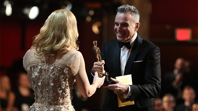 """Cate Blanchett, left, embraces Daniel Day-Lewis as she accepts the award for best actress in a leading role for """"Blue Jasmine"""" during the Oscars at the Dolby Theatre on Sunday, March 2, 2014, in Los Angeles. (Photo by Matt Sayles/Invision/AP)"""