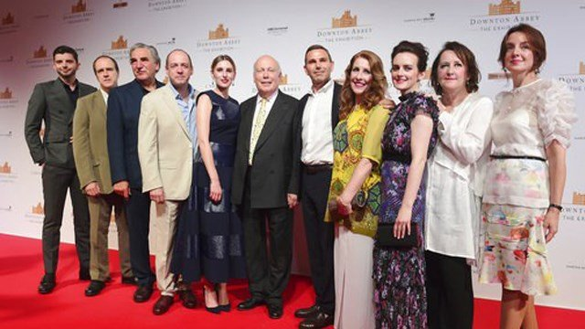 (AP Photo/Joseph Nair). The cast and producers of Downton Abbey on the red carpet at the launch of an exhibition about the television series at the Marina Bay Sands on Wednesday, June 21, 2017, in Singapore.