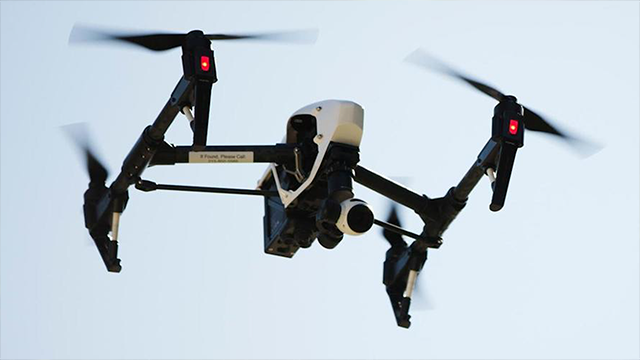(AP Photo/Matt Rourke, File) Three people have been arrested, accused of trying to use a drone to drop a cell phone and drugs into a Michigan prison.