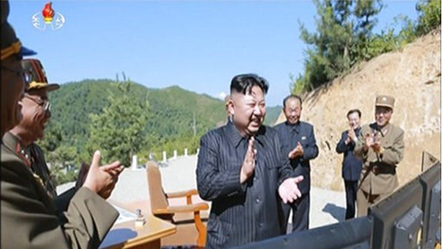 (KRT via AP Video). This image made from video of a news bulletin aired by North Korea's KRT on Tuesday, July 4, 2017, shows what was said to be North Korea leader Kim Jung Un, center, applauding after the launch of an intercontinental ballistic missile.